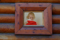 Window and a girl with the christmas har Royalty Free Stock Image