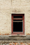 Window without glass in an abandoned brick building Royalty Free Stock Photo