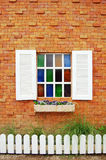 Window with Glass Color. A window is a transparent or translucent opening in a wall, door or vehicle that allows the passage of light and, if not closed or Stock Photo