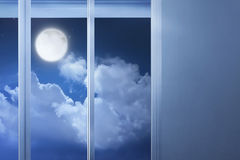 Window glass in the empty room with moonlight Royalty Free Stock Image