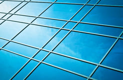 Window glass reflection of cloudy sky Stock Images