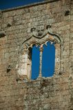 Window in gothic style on a stone wall stock photo