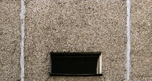 Window and gray block wall texture of an apartment high-rise building.  Stock Images