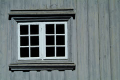 Window on a gray wall. Window on a gray, wooden wall Stock Photo