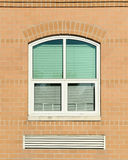 Window with green blinds. Window on brick wall with green blinds Royalty Free Stock Photography