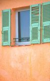 Window with green damaged shutters in France royalty free stock images