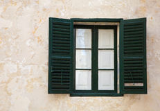Window with green shutters. On old wall at mediterranean town Royalty Free Stock Image