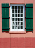 Window and green shutters in european village Royalty Free Stock Photo