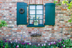 Window with green shutters Royalty Free Stock Photography