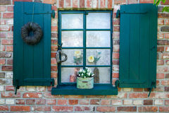 Window with green shutters Royalty Free Stock Photo