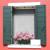 Window with green wooden shutters Royalty Free Stock Photography