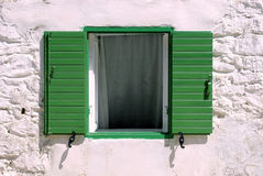 Window with green wooden shutters, Greece Stock Image