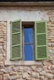 Window with green wooden shutters Stock Photos