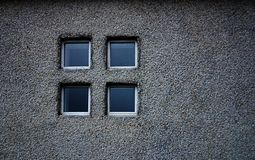 Window on grey. 4 panes of glass in a coarse grey wall Stock Photos