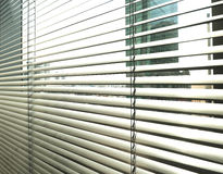 Window grey metallic jalusie sunblinds. Background office Stock Photos