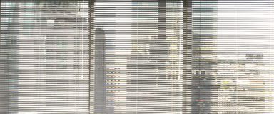 Window grey metallic jalusie sunblinds. Background office Royalty Free Stock Photos