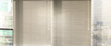 Window grey metallic jalusie sunblinds. Background office Royalty Free Stock Image