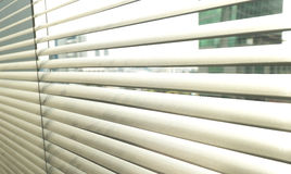 Window grey metallic jalusie sunblinds. Background office Stock Images