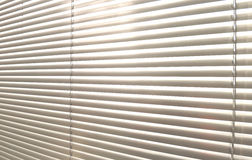 Window grey metallic jalusie sunblinds. Background office Stock Image