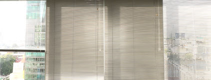 Window grey metallic jalusie sunblinds. Background office Stock Photo