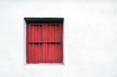 Window guard on a old wall house Stock Photo