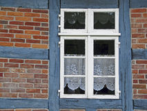 Window of a half-timbered house in North Germany Stock Image