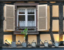 Window  of a half-timbered house with open shutters. Royalty Free Stock Photos