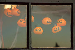 Window with Halloween decoration. Of little pumpkins Royalty Free Stock Photography