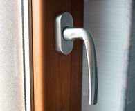 Window handle with faux wood frame Stock Image
