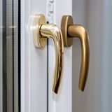 Window handles on plastic window Stock Photography