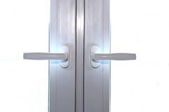 Window handles on windows Stock Photography