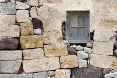 Window On History. This image is a detail from what once was a house in Ancient Thira, the oldest city on the Greek Island on Santorini. This ancient city is stock image