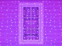 Window of the house decorated with Christmas and Christmas purple lights. Royalty Free Stock Photography