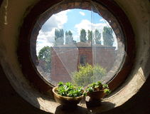 Window of a house factory. Round window with residential buildings for workers Scheibler old factory in Lodz Stock Images