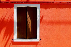 Window house on orange color wall Royalty Free Stock Image