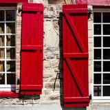 Window of house with red wooden shutters in Vitre. Travel to France - window of old house with red wooden shutters in Vitre town in Ille-et-Vilaine department of Royalty Free Stock Images