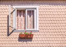 Window of a house with traditional architecture style of south of Chile with wood shingles - Frutillar, Chile. Window of a house with traditional architecture stock photos