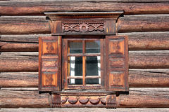 Window of a house with wood carvings Stock Images