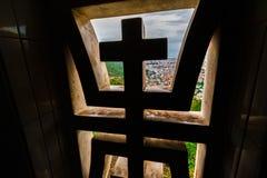 Window with hristrianskim cross overlooking city Stock Photos