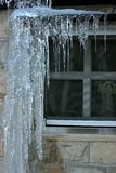 Window with icicles Royalty Free Stock Photo