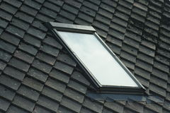 Window inside a roof. House roof with a window inside Royalty Free Stock Photography