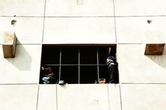 Window installation. Plant construction site, workers are installing window height Stock Images