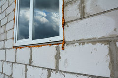 Window installation and Replacement Details. Window Construction with Insulation. Stock Photo