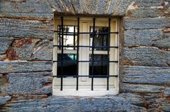 Window with iron bars. The modern window bars offer a more avant-garde style to your home. They are manufactured with an angle frame and an internal framework Royalty Free Stock Image