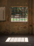 Window with iron bars in old wall. In Brazil Stock Photo