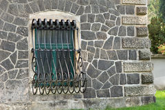 Window with iron grating and old wall. Of a castle Royalty Free Stock Image