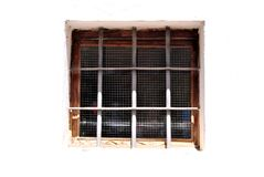 Window with iron security. Bars in the wall of white bricks and cement Royalty Free Stock Image