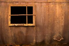 Window in an iron wall. On a rusty background Royalty Free Stock Photos
