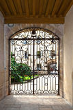 Window with iron window grate in famous hospice in Beaune, Franc. E Royalty Free Stock Photo
