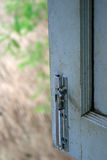 Window latch. On a timber old window panel Stock Photo